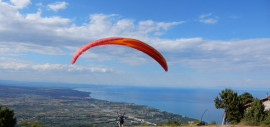tandem paragliding to the beach
